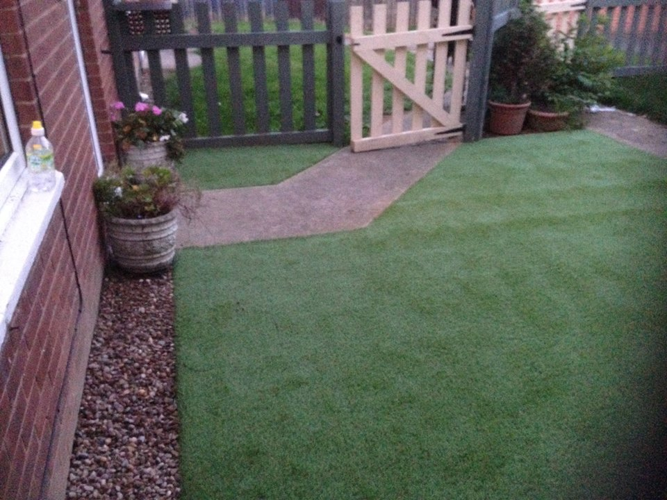 small garden with synthetic grass