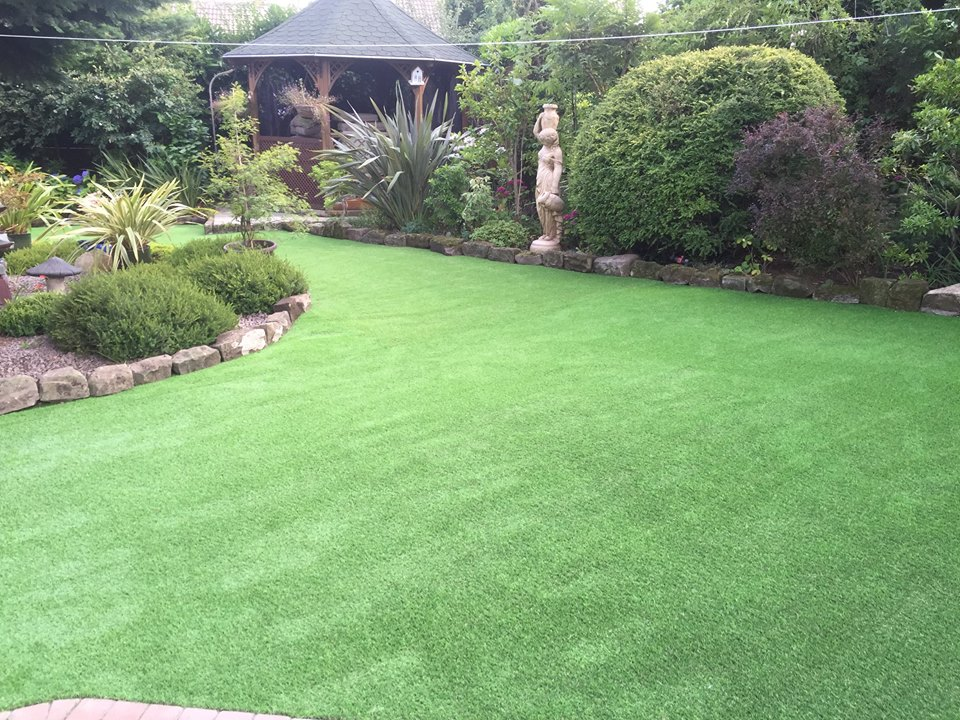 artificial grass for dogs in a back garden