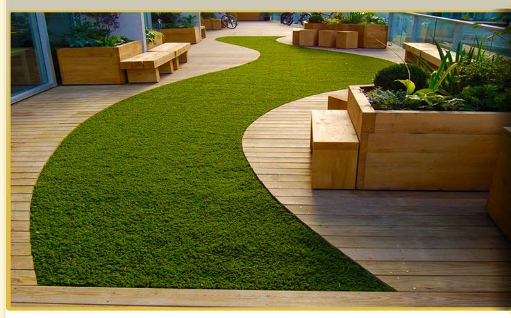 articiial grass with decking in Sherwood