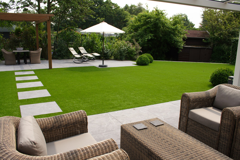 beautiful lawn with patio furniture